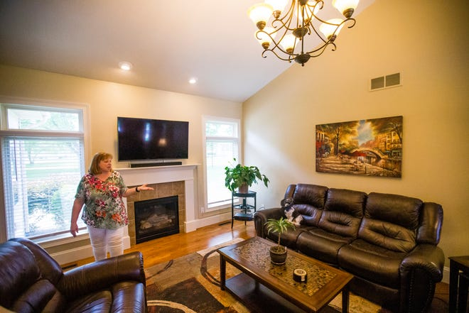 Sue Reynolds talks about the size of her new home Friday in South Bend.