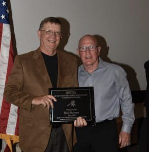 Rod Bohner, retired Roland-Story staff member, was honored by the Iowa Wrestling Coaches and Officials Association as a Gold Standard Assistant Coach for his 34 years working with the Roland-Story program.Bohner, left, is pictured with Jim Miller, director of the National Hall of Fame Dan Gable Museum in Waterloo.
