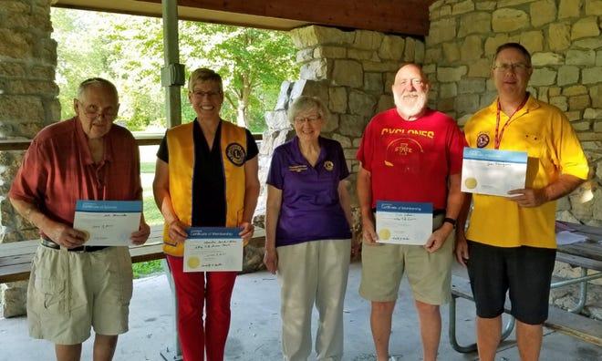 Pictured are Dale Henricks (sponsor), Christine Semler-Blue (new member), Charlotte Miller (2020-2021 president), Ole Skaar (new member) andJohn Narigon (sponsor).