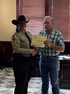 The Erath County Commissioners Court met Monday and recognized years of service for several county employees. Kim Johnson, left, was recognized for five years of service. She started her career with the Erath County Sheriff's Office as a dispatcher. She recently completed the Law Enforcement Police Academy at Weatherford College and is moving to the patrol division where she will be a sworn deputy.