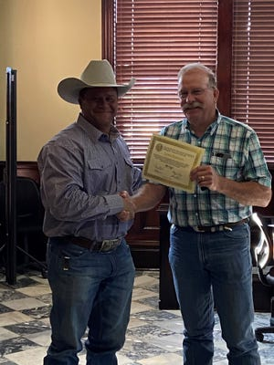 The Erath County Commissioners Court met Monday and recognized years of service for several county employees. Lt. James Robison, left, was recognized for his 10 years of service to the citizens of Erath County. Robison is on the enforcement side of the Erath County Sheriff's Office. He is responsible for supervising the CID, court division, and the mental health division along with managing loose livestock reported in Erath County.