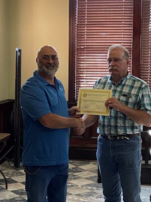 The Erath County Commissioners Court met Monday and recognized years of service for several county employees. Rusty Jennings, left, a dispatcher with the Erath County Sheriff's Office, was recognized for his 10 years of service to the citizens of Erath County.
