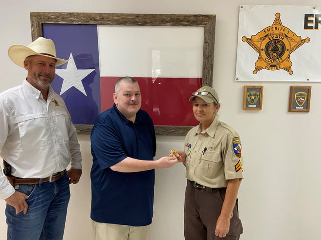 Erath County Sheriff Cpl. Lydia Gray was recently promoted to Lt. Gray in the Jail division. Sheriff Matt Coates, left, and Capt. Danny Clayton announced the promotion.