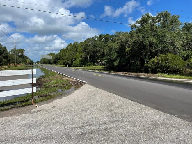 Flood water levels along Tropicaire Boulevard in North Port were still receding Monday morning.