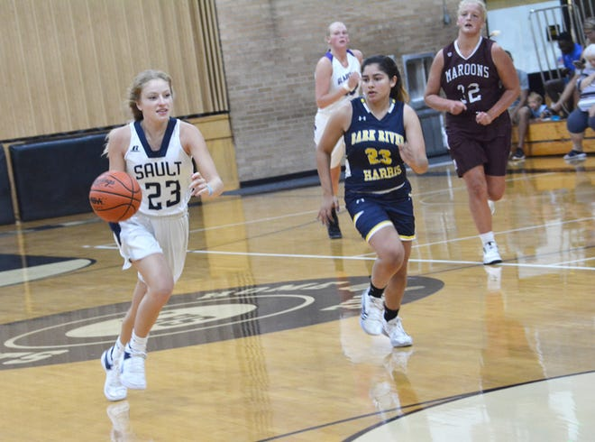 Jordyn Haller (23) of Sault High leads a fast break for the East during the All-Star Classic at St. Ignace Saturday. Haller scored 16 points for the East in an 87-80 win over the West.