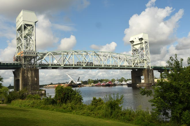 The Department of Transportation suspended its next round of STIP projects due to funding issues, leaving the Cape Fear Memorial Bridge replacement project in doubt.