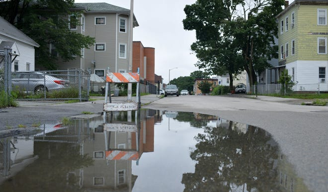 All that is left from last week's tropical storm flooding that occurred in Worcester is a large puddle Monday on Southgate Street.