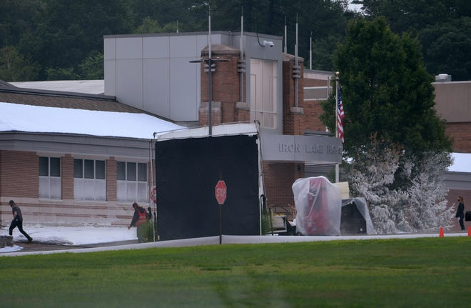 """BOLTON -  A tree is sprayed with fake snow at the bottom and is left green at the top as filming continued for popular series """"Dexter"""" at Nashoba Regional High School on Monday."""