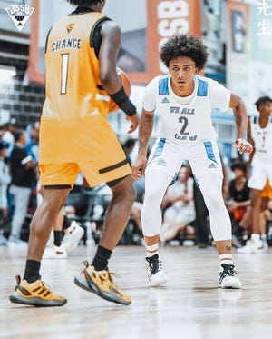 Five-star 2023 recruit and Lake Norman Christian guard Mikey Williams (2) played in last weekend's NCAA live period with the Memphis-based We All Can Go All-Stars AAU basketball program. UNC's Hubert Davis was among the many coaches sitting courtside for the event.