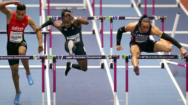 US Virgin Islands' Eddie Lovett, center, competes during a men's 60-meter hurdles heat at the World Athletics Indoor Championships in Birmingham, Britain, in 2018.