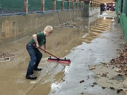Six-year-old Cooper Mathers was bound and determined to redirect the flood waters from a barn at the Orange County Fair on July 10. He spent hours committed to the task and it was difficult for his parents to finally pull him away.