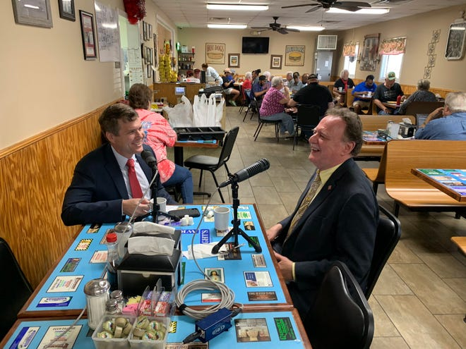 """Tuscaloosa Mayor Walt Maddox, left, speaks with Council President Kip Tyner for the inaugural episode of the """"Tuscaloosa Talk"""" podcast at Wright's Restaurant in Alberta."""