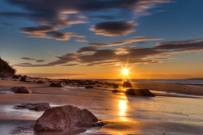 A photograph of the sunrise at Sandy Point by Katharine Langenberg.