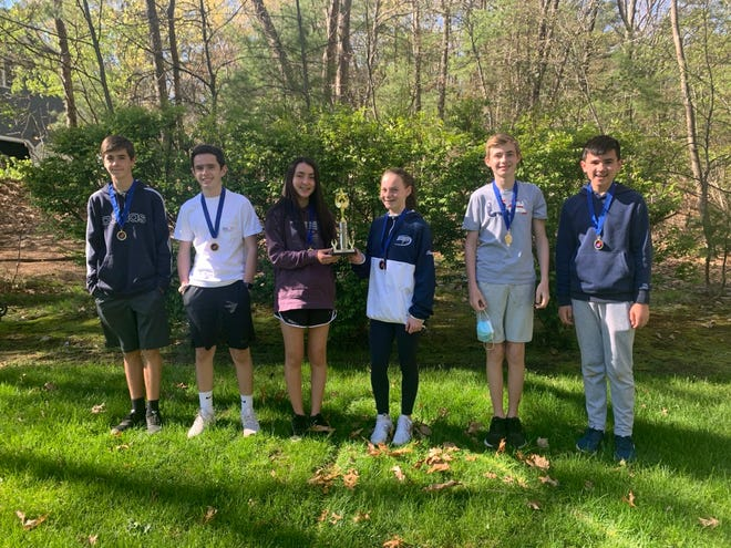 From left, with their first place medals and DI States trophy, Medfield eighth-graders: Mark Tierney, John Barrette, Ashlyn Ryan, Adeline Keaveney, Will Boxmeyer and Kieran Ryan.
