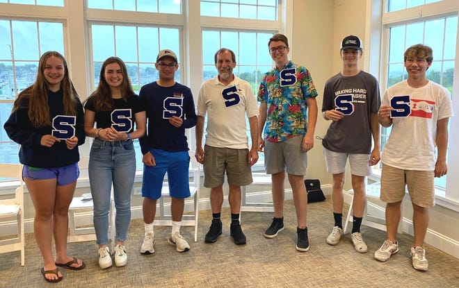 The Scituate High School Varsity Sailing Team celebrated their year-end banquet at the Maritime Center on June 22. From left to right: Claire Murray, Co-Captain Zoe Grant, Co-Captain Eli Murray, Coach Scott Greenbaum, Victor Bowker, Sam Sturdy, and Sam Lauer.