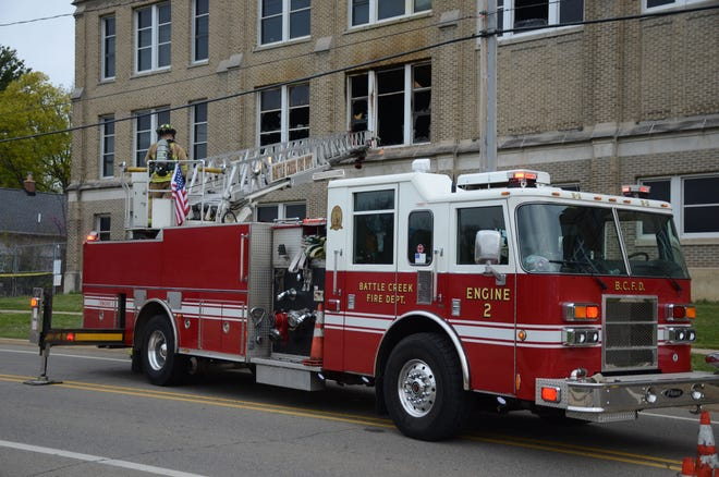Battle Creek firefighters outside Southwestern Junior High School after a fire in April. A second fire was reported Sunday.