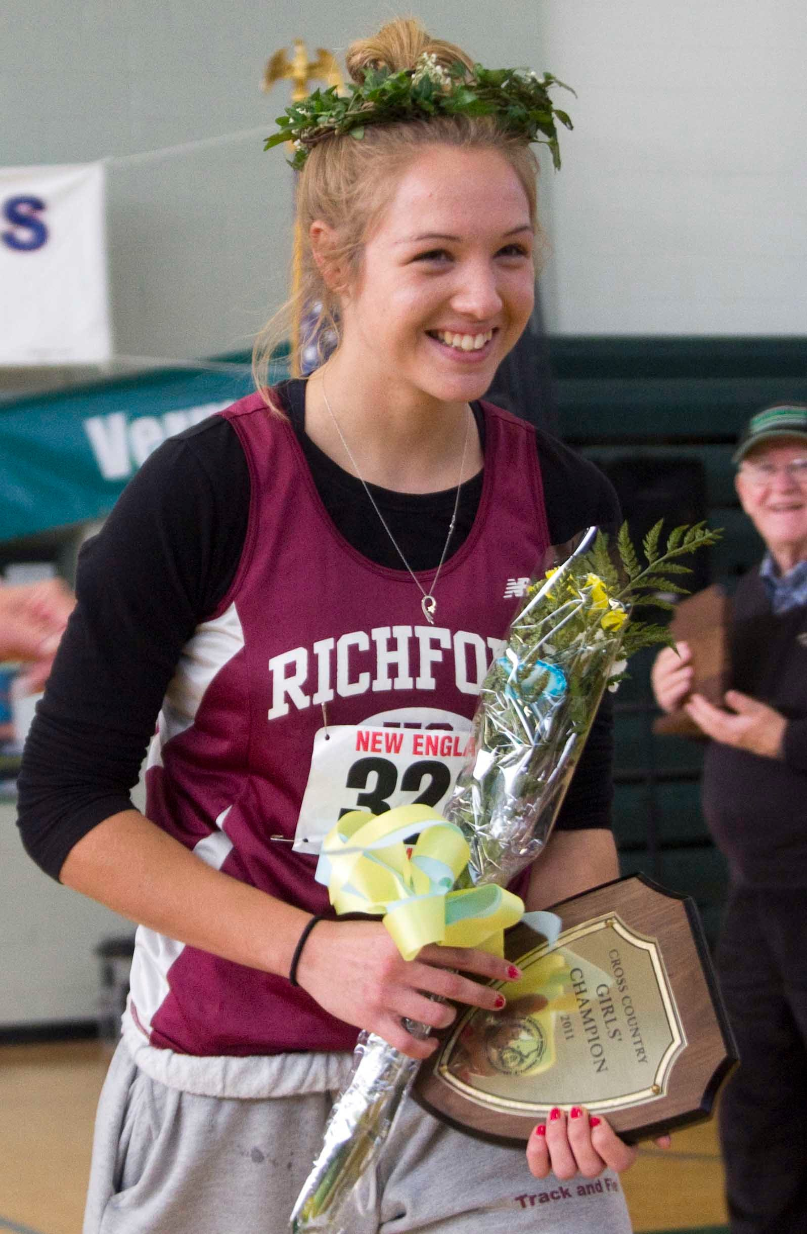 Elle Purrier St. Pierre is honored after winning the 2011 New England XC title.