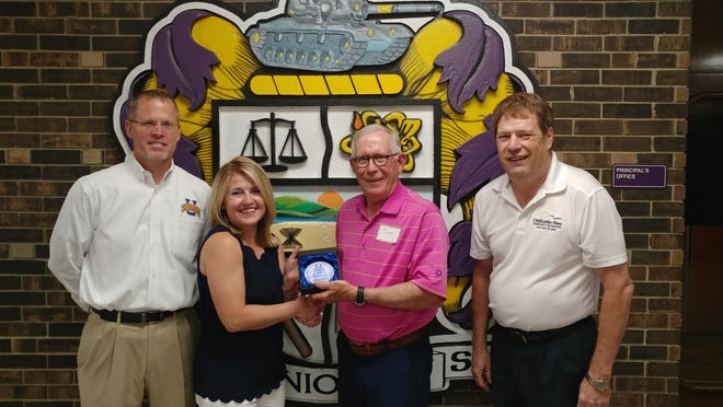 Unioto Superintendent Matt Thornsberry, Brianna Jenkins, Scholarship Board Member and Class of 1971 Alumni Mike Lansing and Chillicothe-Ross Community Foundation Executive Director Scott Graham pose for a photo after Jenkins was presented the award.