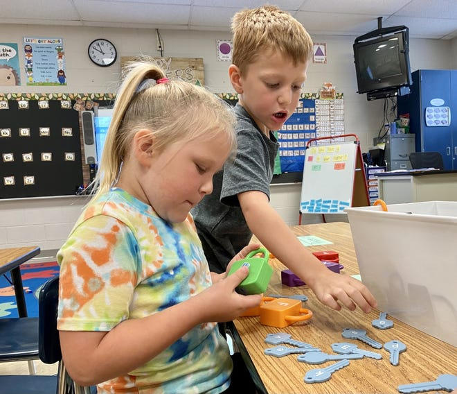 Children who will be attending Zane Trace Elementary School this year but who have never been to preschool participate in a letter learning activity on Monday, July 12. While they're learning how to recognize the different letters of the alphabet, the kids are also socializing and having fun.