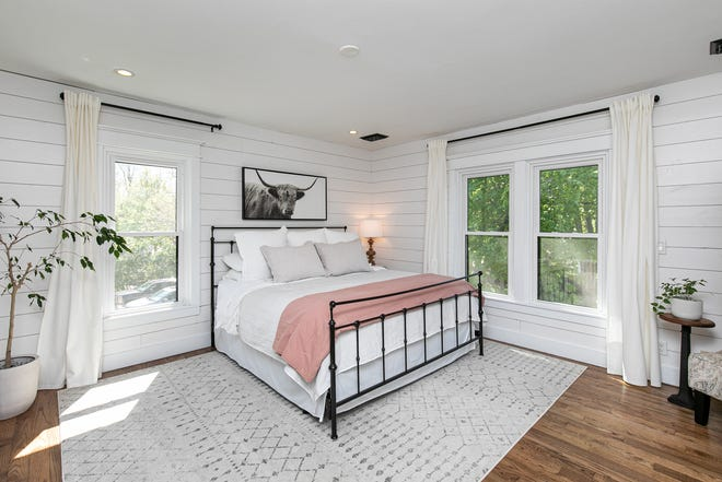 Victorian charm and modern farmhouse aesthetic blend seamlessly in this new listing in Dallas Center.
