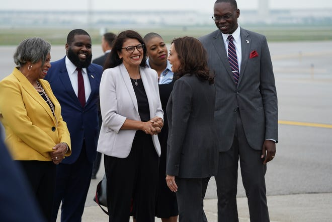 Vice President Kamala Harris is greeted by Lt. Gov. Garlin Gilchrist II, U.S. Rep. Brenda Lawrence and U.S. Rep. Rashida Tlaib after she exits Air Force Two at Detroit Metropolitan Wayne County Airport in Romulus on Monday, July 12, 2021 during a stop to Detroit.