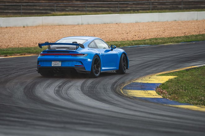 Around Road Atlanta's swooping curves the 2022 Porsche 911 GT3 is imperturbable, its rear-wheel-steer and double-wishbone front suspension making for sharp handling.