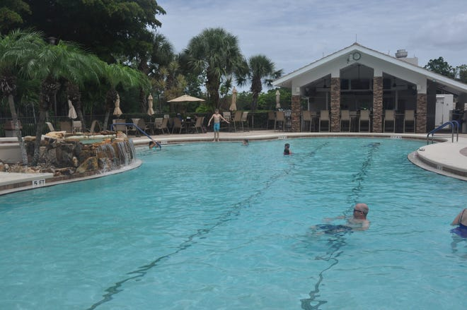 Residents enjoy the pool and club at Heritage Palms. Besides this main pool there are seven smaller community pools.