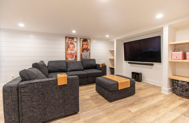 An entertainment area in the basement of Cody and Rachel Hambleton's remodeled Strathmoor Village home. July 7, 2021
