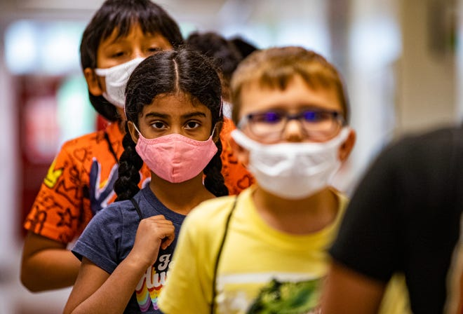 Students attending the JCPS summer program at Middletown Elementary School wore masks while making their way down the hall on Monday, July 12, 2021. Jefferson County Public Schools is requiring unvaccinated students and staff to wear face masks while indoors.
