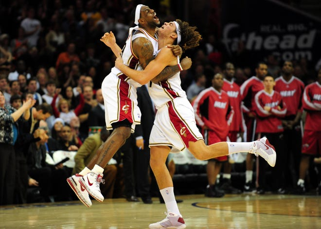 Dec 28, 2008; Cleveland, OH, USA; Cleveland Cavaliers forward LeBron James (23) celebrates with Anderson Varejao (17) after defeating the Miami Heat at Quicken Loans Arena. Mandatory Credit: Andrew Weber-USA TODAY Sports