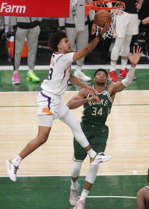 Suns forward Cameron Johnson scores on Bucks forward Giannis Antetokounmpo in Game 3 of the NBA Finals.
