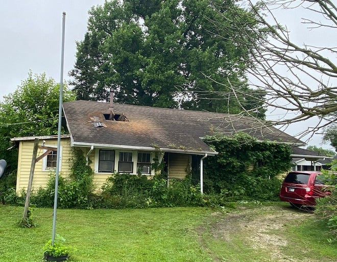 A woman was pronounced dead Monday morning after being removed from the scene of a house fire, in the 400 block of West Delaware County Road 600-S in the unincorporated community of Cowan.