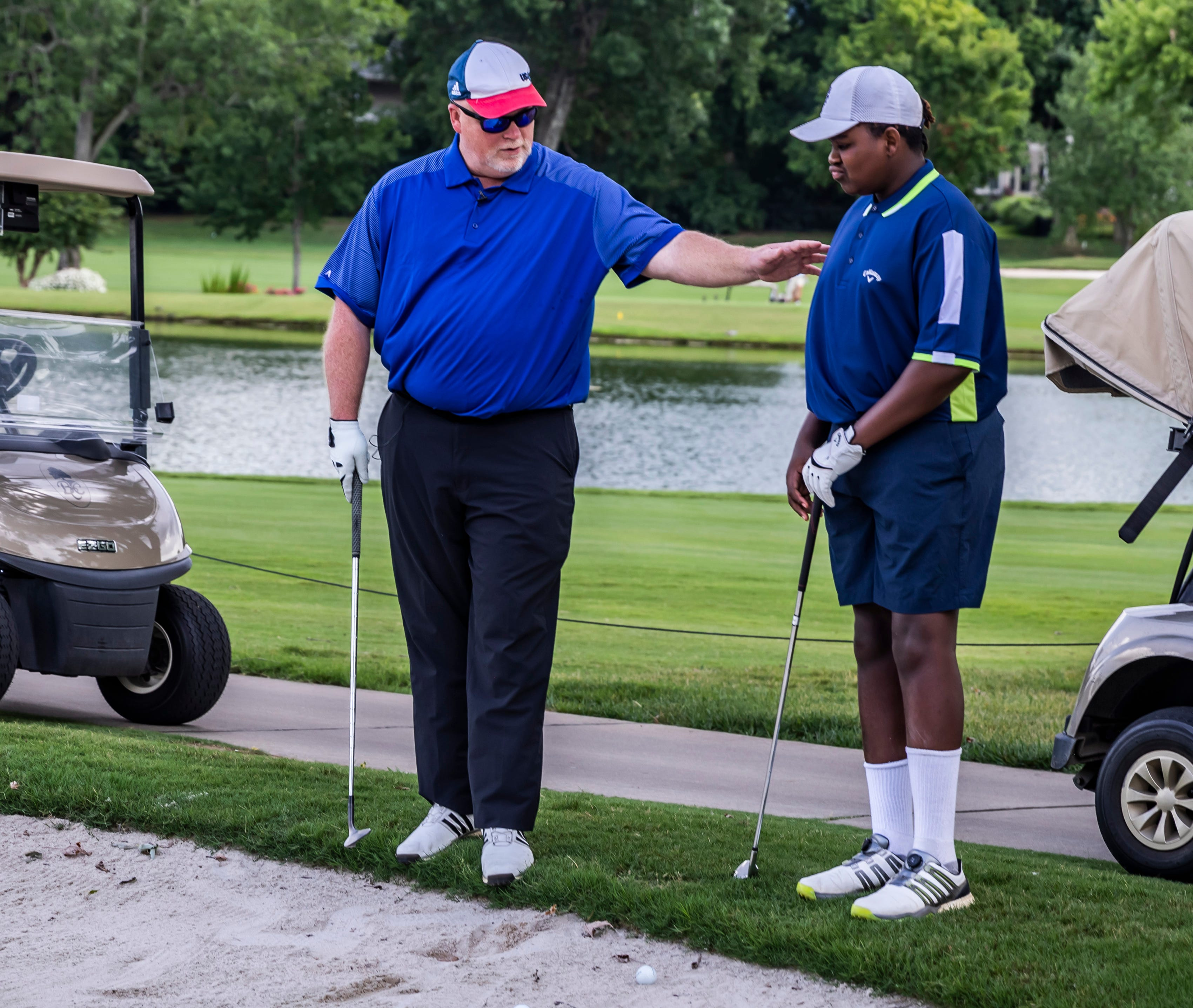 Three-time national champion blind golfer Chad NeSmith teaches Malachi Johnson, who has lost the ability to see, to play the sport Saturday, July 10, 2021 at the Brentwood Country Club.