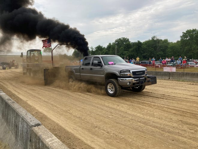 Saturday's opening day saw a series of pull competitions involving vehicles of various weight classes.