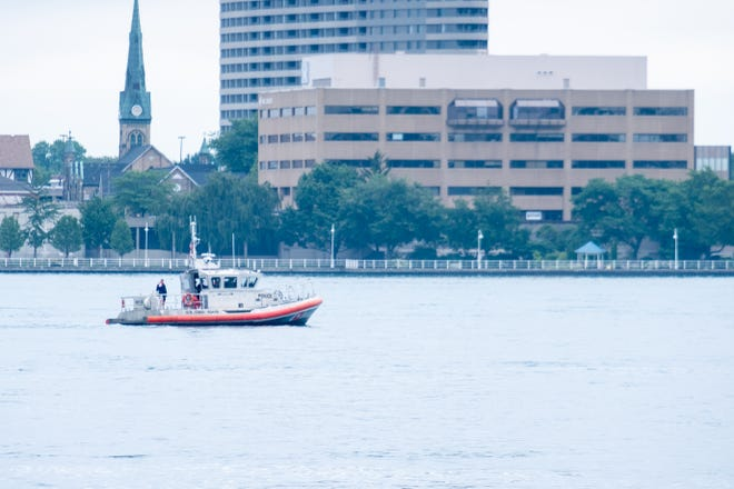 A U.S. Coast Guard boat passes Sarnia, Ontario, after taking part in a water rescue Monday, July 12, 2021, on the St. Clair River.