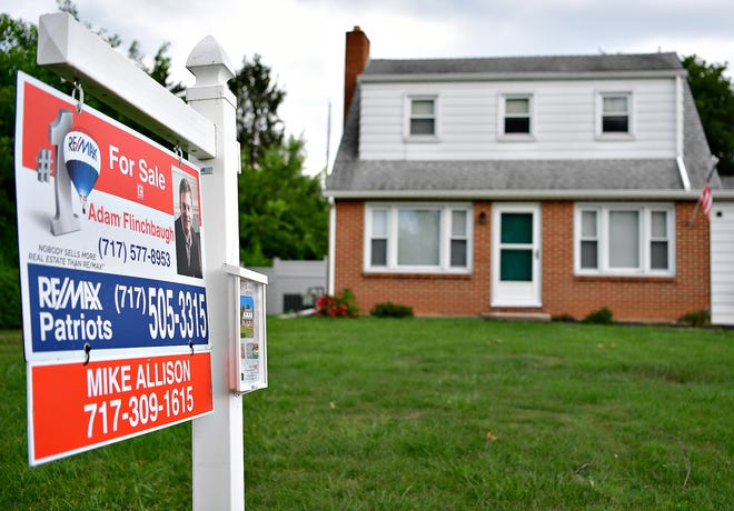 """A """"For Sale"""" sign is posted in the yard of a home on South Findley Street in Springettsbury Township, Monday, July 12, 2021. Dawn J. Sagert photo"""