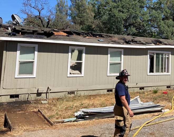 """A house on Lake Boulevard in north Redding was a """"total loss"""" due to fire on Monday afternoon, according to the Redding Fire Department."""