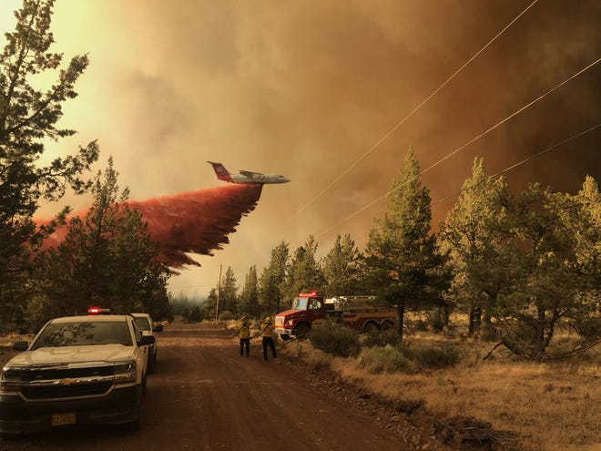 A firefighting tanker making a retardant drop over the Grandview Fire near Sisters on July 11.