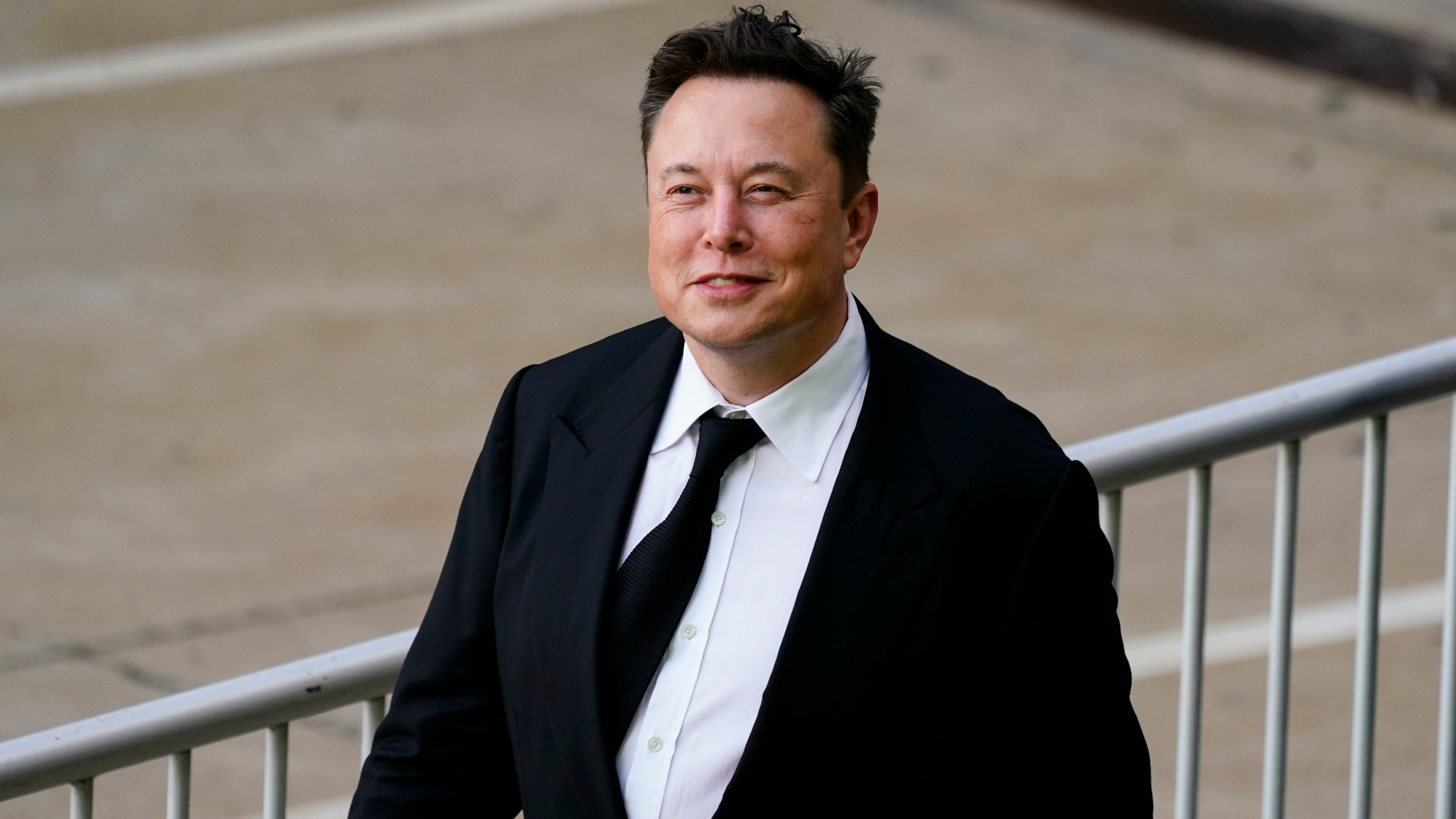 Elon Musk walks from the justice center in Wilmington, Del., Monday, July 12, 2021. Musk took to a witness stand Monday to defend his company's 2016 acquisition of a troubled company called SolarCity against a shareholder lawsuit that claims he's to blame for a deal that was rife with conflicts of interest and never delivered the profits he had promised.