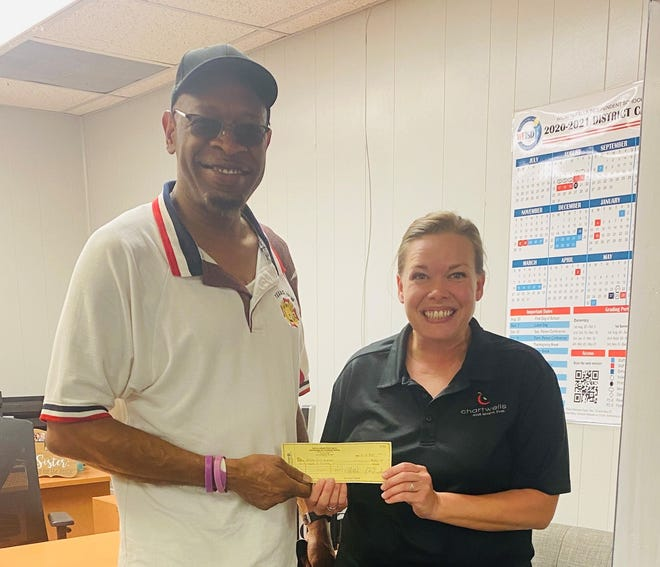 Patrick Brathwait of the David Gibbs Veterans of Foreign Wars Post 8878  gives a donation for Wichita Falls ISD to Carrie Richardson, Executive Chef for WFISD Child Nutrition Department powered by Chartwells K12 on Monday, July 12, 2021.