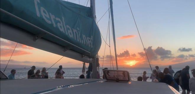 Passengers watch the sun set from a catamaran dinner cruise on the Hawaiian island of Maui on Saturday, July 3rd.