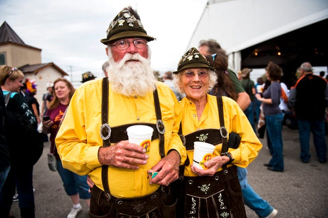 Charlie and Joyce Perron of Corpus Christi model traditional German outfits at Wurstfest on Nov. 5, 2011, in New Braunfels.