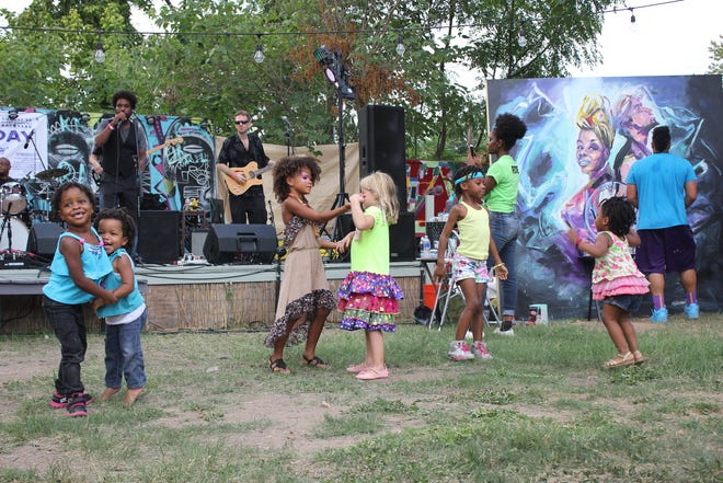 Children dance by the stage at RAS Day 2015 at Kenny Dorham's Backyard. Music Commission chair Chaka Mahone said city support helped him to build the event into a vibrant community happening.