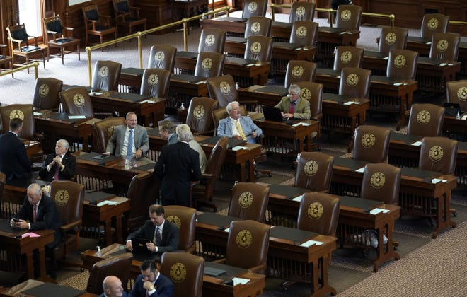 Empty seats are seen in the House Chamber at the Texas Capitol, Tuesday in Austin. Democrats left the state to block sweeping new election laws, while Gov. Greg Abbott threatened them with arrest the moment they return. [AP Photo/Eric Gay]