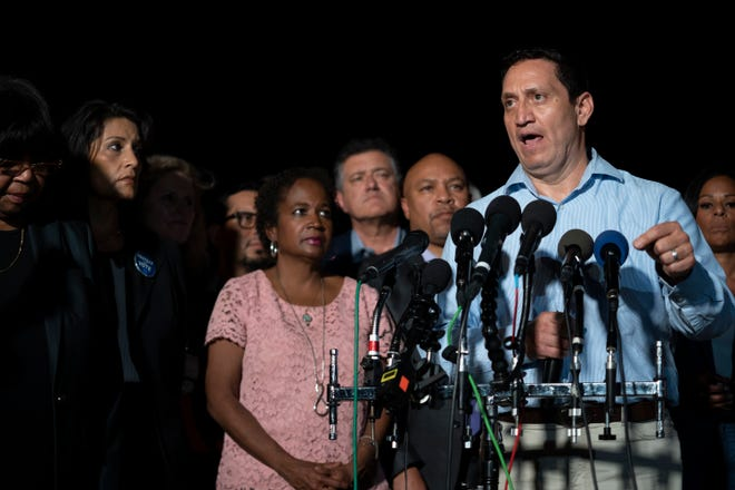 Texas State Rep. Trey Martinez Fischer speaks at a press conference as House Democrats arrive at Dulles Airport in Sterling, Va. on July 13,  after leaving Texas to break quorum.