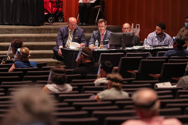 Defense attorneys for Paul Adams listen Monday during the beginning of jury selection at the LBJ Auditorium at the University of Texas. Travis County decided to hold this part of the trial there for pandemic safety, but the jury pool was too small for Adams' trial to continue this week.