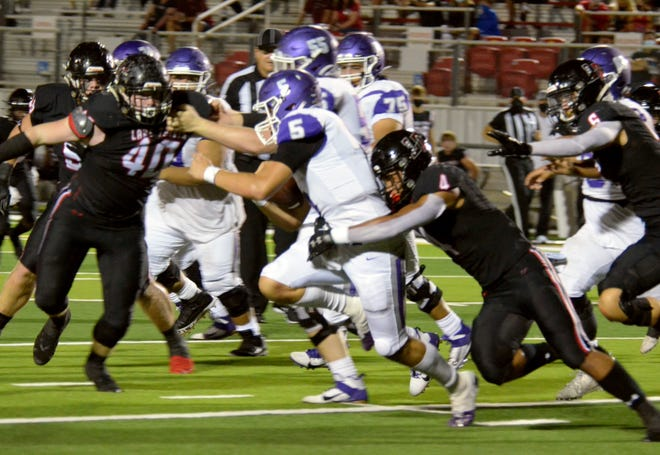 Lake Travis linebacker D.J. Johnson, right, wraps up San Marcos quarterback Isaiah DeLeon in a district game last season. There's not a more experienced linebacker in the Austin area than Johnson, a 6-foot, 195-pound senior who already has 117 career tackles in three previous varsity seasons.