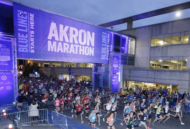 Runners take off from the downtown starting line at the 2018 Akron Marathon.