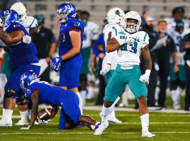 Coastal Carolina linebacker Enock Makonzo celebrates after making a play during last season's win over Kansas at Memorial Stadium in Lawrence. The Chanticleers finished a surprising 11-1, the lone loss coming in overtime against Liberty in the Cure Bowl.
