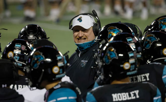 Coastal Carolina offensive coordinator Bill Durkin talks to his players during last season's Cure Bowl game against Liberty. The Chanticleers went on to lose in overtime, their lone loss of the 2020 season.